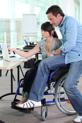 Girl working in a wheelchair