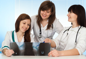 Three charming nurses view image