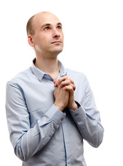 young man praying isolated on white
