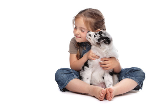 little girl and a puppy