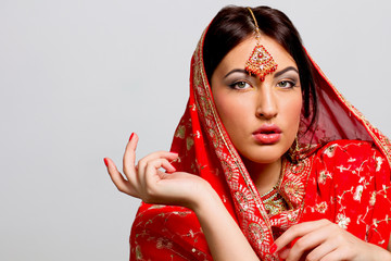 Woman in a red saree
