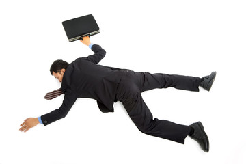 businessman lying down on the ground