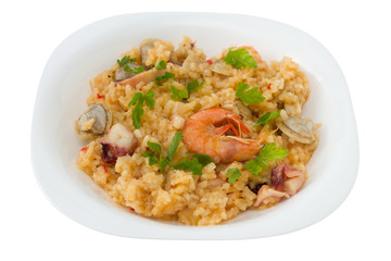 rice with seafood in the white plate