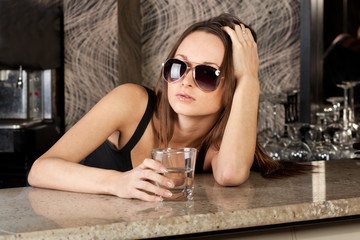 Goreous brunette with a glass