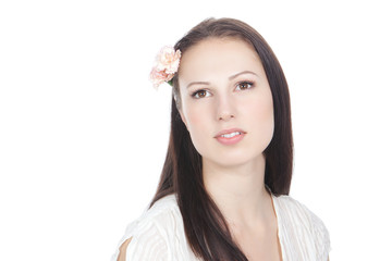 Cute young woman with flower in hair