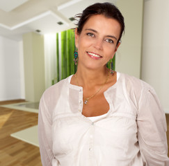 Smiling woman on a Zen interior
