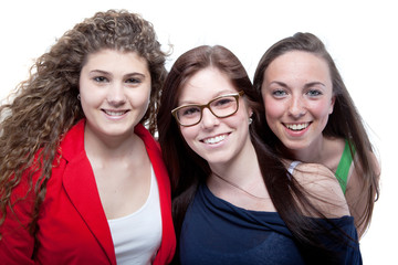 Three cute teenagers isolated over white