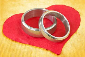 wedding rings on paper heart