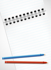 Pencils and blank page of a notebook for your message