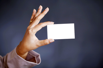 Extended hand a business card
