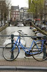 blue bike on canal, amsterdam
