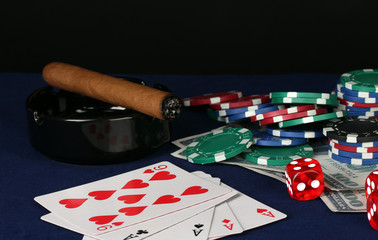 playing cards and poker chips on table