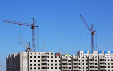 crane and blue sky on building site