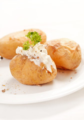 Baked potato filled with soft cheese