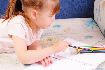 Pretty little girl draws picture