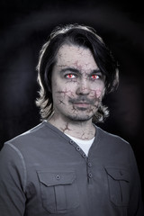 Portrait of a male zombie with cracked skin
