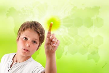 Boy touching futuristic green interface.