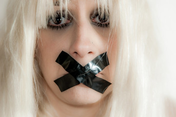 Muted woman with adhesive tape