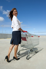 Sexy woman with shopping trolley