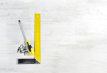 Screwdriver with screw and ruler. Tools set for construction wor