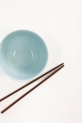 a bowl & chopstick, white background