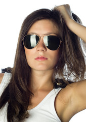 Fashion young woman wearing white top with sunglasses