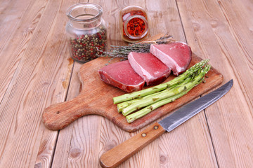 meat food : raw beef fillet on cutting board