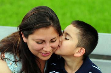 Son kissing mom on cheek