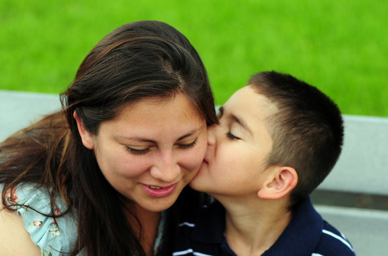 Son kissing mom on cheek