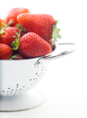 Strawberries in a white drushlake isolated background