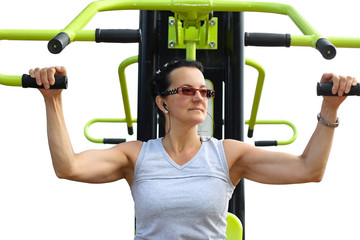 Young woman exercising on machine isolated