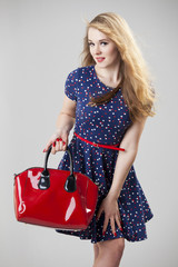 Retro woman with red bag
