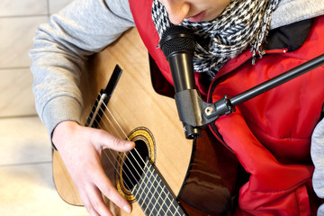 man playing and singing classic guitar