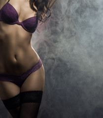 Fashion shoot of a young and sexy woman in lingerie
