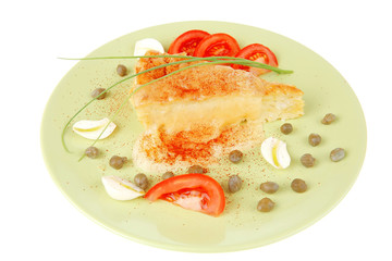 casserole piece over green plate served with chives and tomatoes