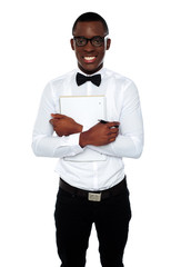African guy holding spiral notebook