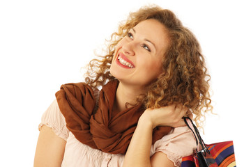 Portrait of a happy young woman holding shopping bags
