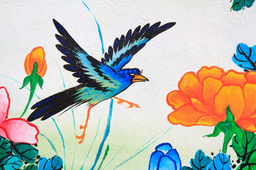 bird painting on a wall in Chinese temple