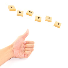 Male hand showing thumbs up sign with profit button
