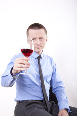 Young businessman with a glass of wine