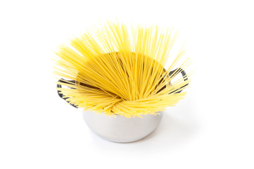 spaghetti noodles in a pot on a white background