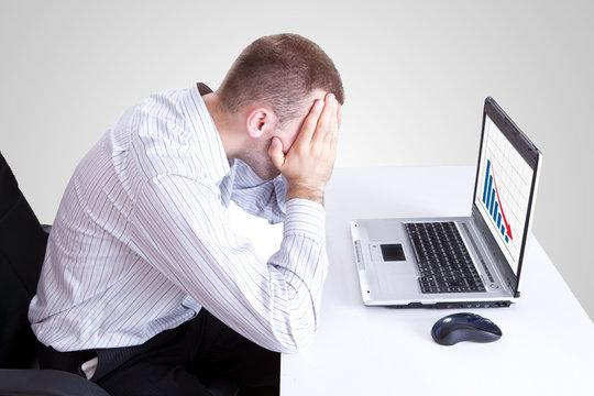 man looking at a bad results chart