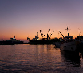 Silhouettes of ships in port