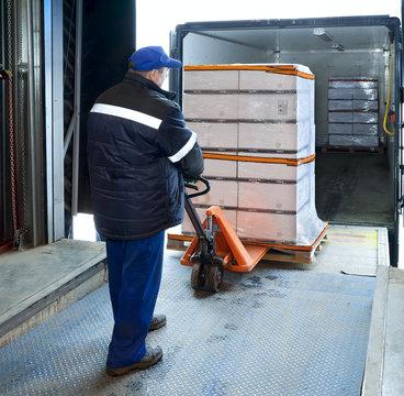 Worker loading on truck