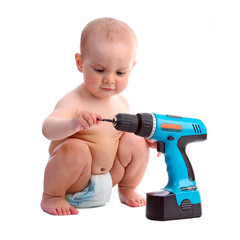 One-year old boy taking an interest in a screwdriver