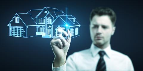 businessman draws house