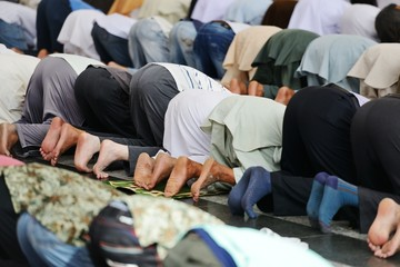 Wall Mural - Muslims praying together at Holy mosque