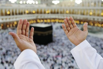 Wall Mural - Muslim praying at Mekkah with hands up