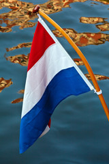Dutch flag hanging above a canal