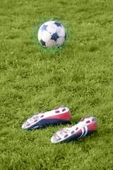 Fussballschuhe und Fussball